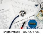 stethoscope and calculator... | Shutterstock . vector #1027276738