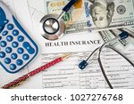 stethoscope and calculator... | Shutterstock . vector #1027276768