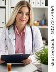 beautiful smiling female doctor ... | Shutterstock . vector #1027277464