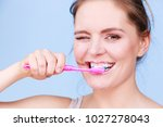 woman brushing cleaning teeth.... | Shutterstock . vector #1027278043