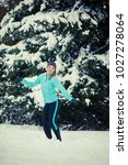 sporty girl jumping in snow... | Shutterstock . vector #1027278064