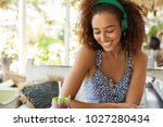 happy dark skinned mixed race... | Shutterstock . vector #1027280434