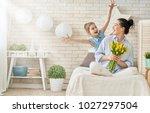 happy women's day  child... | Shutterstock . vector #1027297504