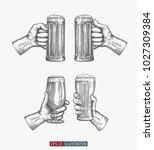 hands holding beer glasses set. ... | Shutterstock .eps vector #1027309384