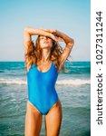 beautiful attractive woman in... | Shutterstock . vector #1027311244