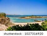 boat on the beach  fiji islands | Shutterstock . vector #1027316920