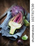 fresh purple artichokes on dark ... | Shutterstock . vector #1027317130