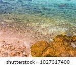 rocks on the beach  rocks in... | Shutterstock . vector #1027317400
