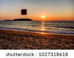 dramatic sunset on one of the... | Shutterstock . vector #1027318618