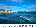 the beach of cullera and the... | Shutterstock . vector #1027321054