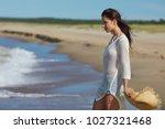 woman enjoying a walk on the... | Shutterstock . vector #1027321468