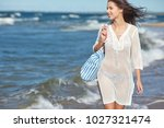 woman enjoying a walk on the... | Shutterstock . vector #1027321474