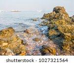 rocks on the beach  rocks in... | Shutterstock . vector #1027321564