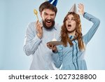 friends in holiday caps on a... | Shutterstock . vector #1027328800