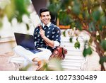 handsome indian man working as... | Shutterstock . vector #1027330489