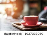 coffee latte on table in cafe... | Shutterstock . vector #1027333060