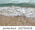 sea wave with bubbles hits the... | Shutterstock . vector #1027334218