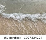 sea wave with bubbles hits the... | Shutterstock . vector #1027334224