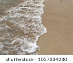 sea wave with bubbles hits the... | Shutterstock . vector #1027334230