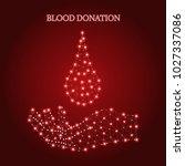 polygonal hand holds of blood... | Shutterstock .eps vector #1027337086