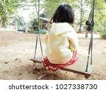 little baby sitting swing home...   Shutterstock . vector #1027338730