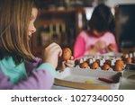 two girls enjoying in easter... | Shutterstock . vector #1027340050