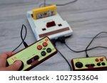 the hand hold hori controller... | Shutterstock . vector #1027353604