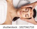 face massage.  close up of... | Shutterstock . vector #1027361710