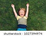happy child having fun outdoors.... | Shutterstock . vector #1027394974