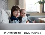 little baby boy and his older... | Shutterstock . vector #1027405486