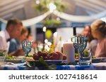wedding banquet. table close up | Shutterstock . vector #1027418614