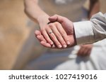 groom and brides hands with... | Shutterstock . vector #1027419016