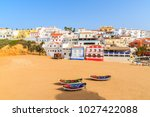 beach with fishing boats in... | Shutterstock . vector #1027422088