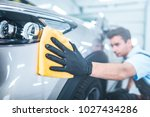 car detailing   the man holds... | Shutterstock . vector #1027434286