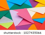 different colored envelopes on... | Shutterstock . vector #1027435066