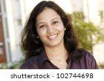 portrait of happy young indian... | Shutterstock . vector #102744698