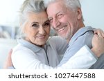 happy senior couple at home | Shutterstock . vector #1027447588