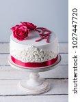 beautiful white wedding cake... | Shutterstock . vector #1027447720
