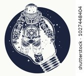astronaut in a light bulb... | Shutterstock .eps vector #1027448404