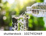 drinking water pouring from... | Shutterstock . vector #1027452469
