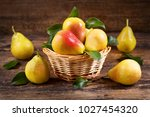 Fresh Pears With Leaves In A...