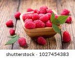 bowl of fresh raspberries on... | Shutterstock . vector #1027454383