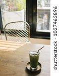 iced milk green tea on wooden... | Shutterstock . vector #1027463896