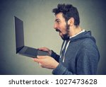 side view of extremely amazed...   Shutterstock . vector #1027473628