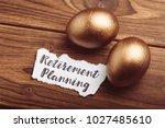 gold eggs on wooden table | Shutterstock . vector #1027485610