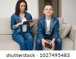 happy mother and son sitting on ...   Shutterstock . vector #1027495483