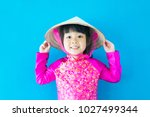 happy little asian girl wearing ... | Shutterstock . vector #1027499344