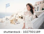 happy woman in white dress and... | Shutterstock . vector #1027501189