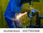 the worker grinding the steel... | Shutterstock . vector #1027502368