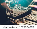 Small photo of professional stage sound mixer closeup at sound engineer hand using audio mix slider working during concert performance